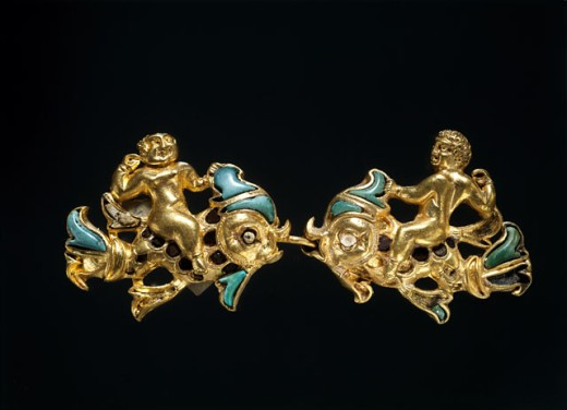 Bactrian Gold: Clasps of Cupids Riding Dolphins Artist Unknown Kabul Museum, Afghanistan  : Stock Photo