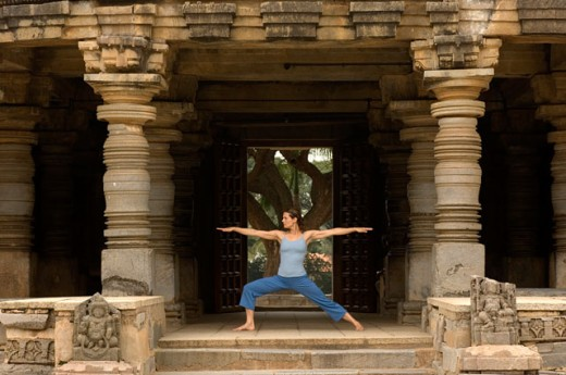 Young woman practicing Virbhadrasana : Stock Photo