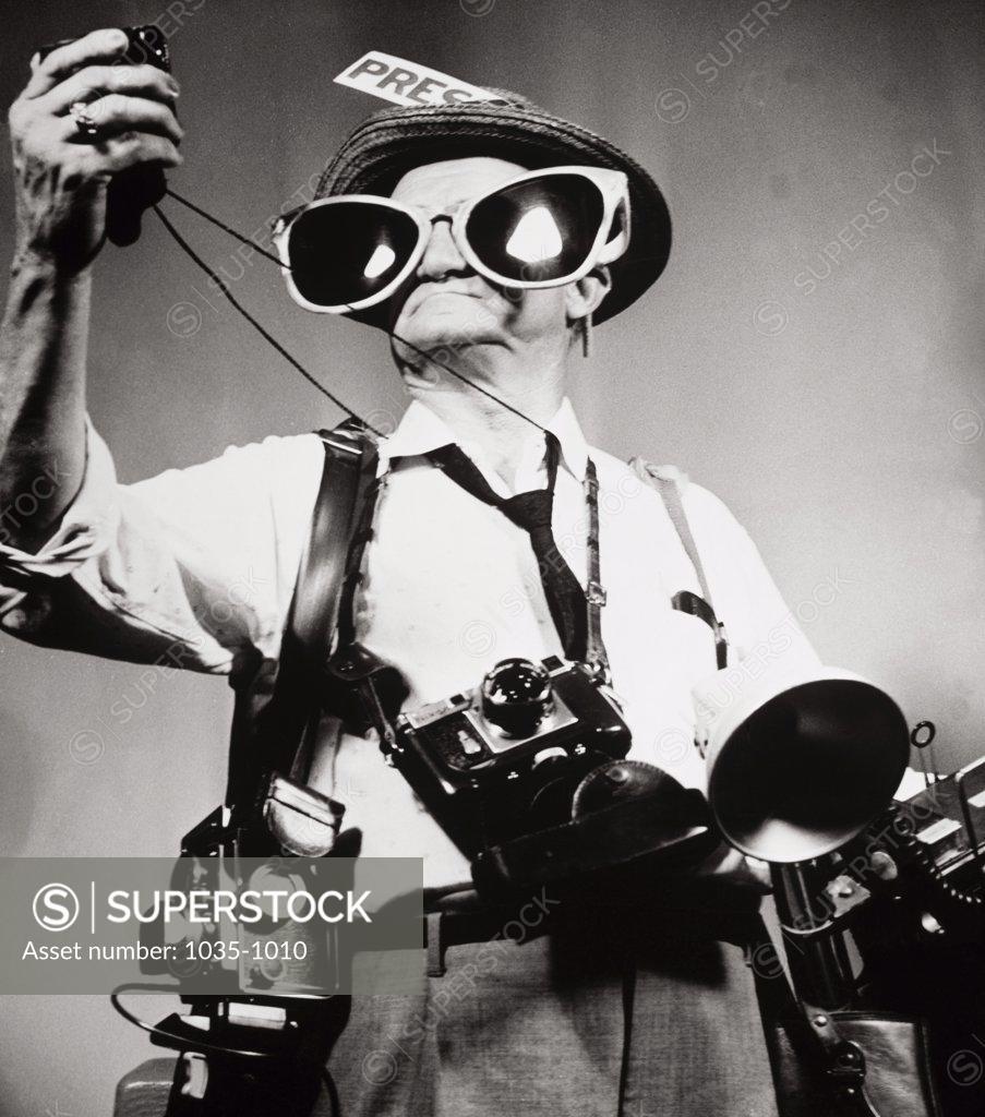 Stock Photo: 1035-1010 Journalist wearing oversized sunglasses