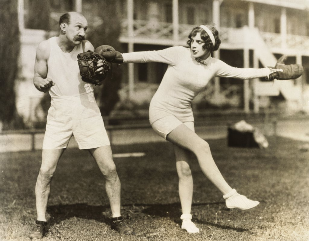 Stock Photo: 1035-1125 Young woman punching a mature man