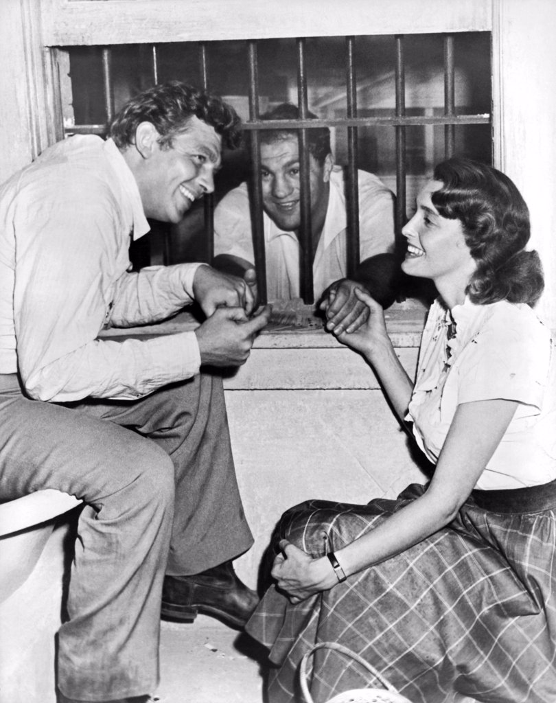 Hollywood, California:  1957. Retired heavyweight champion Rocky Marciano gets consoled on the set of 'A Face In The Crowd' by stars Andy Griffith and Patricia Neal. Marciano was visiting his friend Elia Kazan, director of the film. : Stock Photo