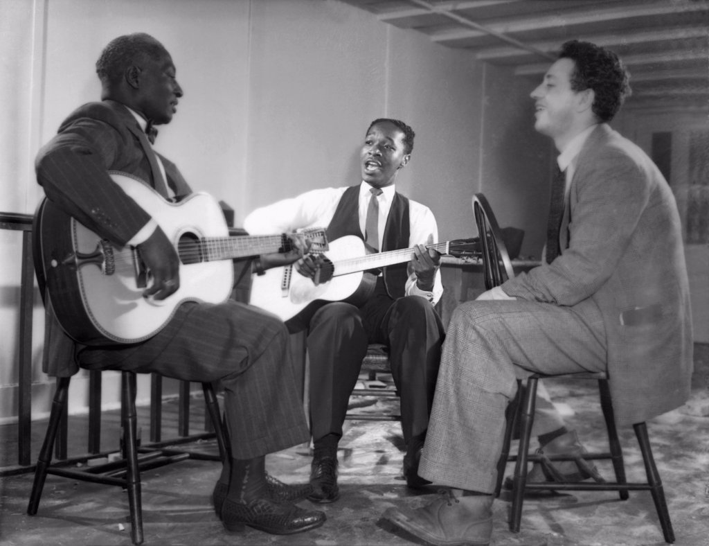 Stock Photo: 1035-11496 New York, New York:  c. 1940. L-R: Leadbelly, Josh White and Nicholas Ray. Ray became a film director; amongst his more notable films was 'Rebel Without A Cause', starring James Dean.