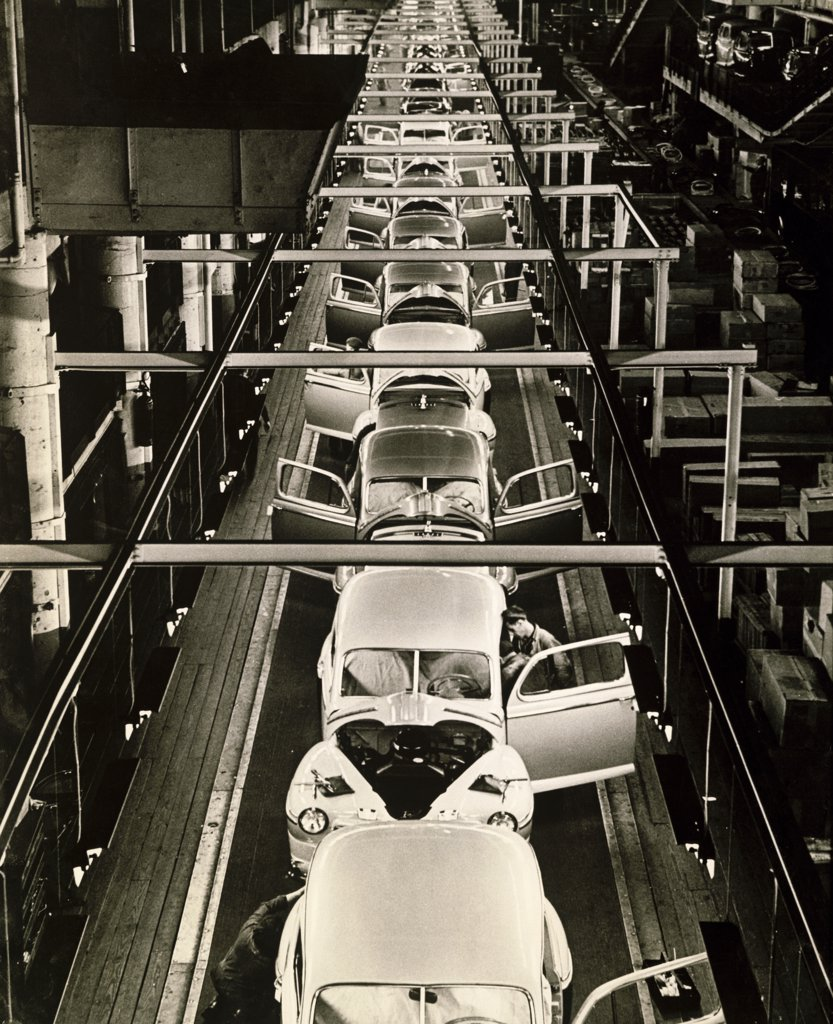 High angle view of manufactured cars on an assembly line in a factory, Dearborn, Michigan, USA, 1946 : Stock Photo