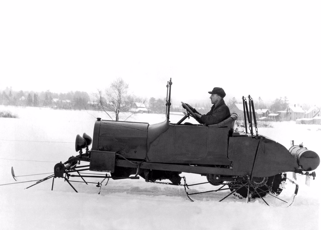 United States:  January 13, 1927. An intrepid inventor tries out his version of an early snowmobile. : Stock Photo