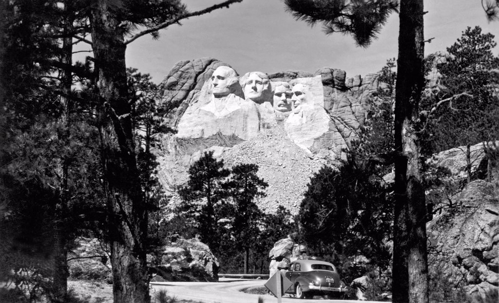 Stock Photo: 1035-11579 Mount Rushmore, South Dakota:  c. 1941. The finished Mount Rushmore sculpture by Guzon Borglum.