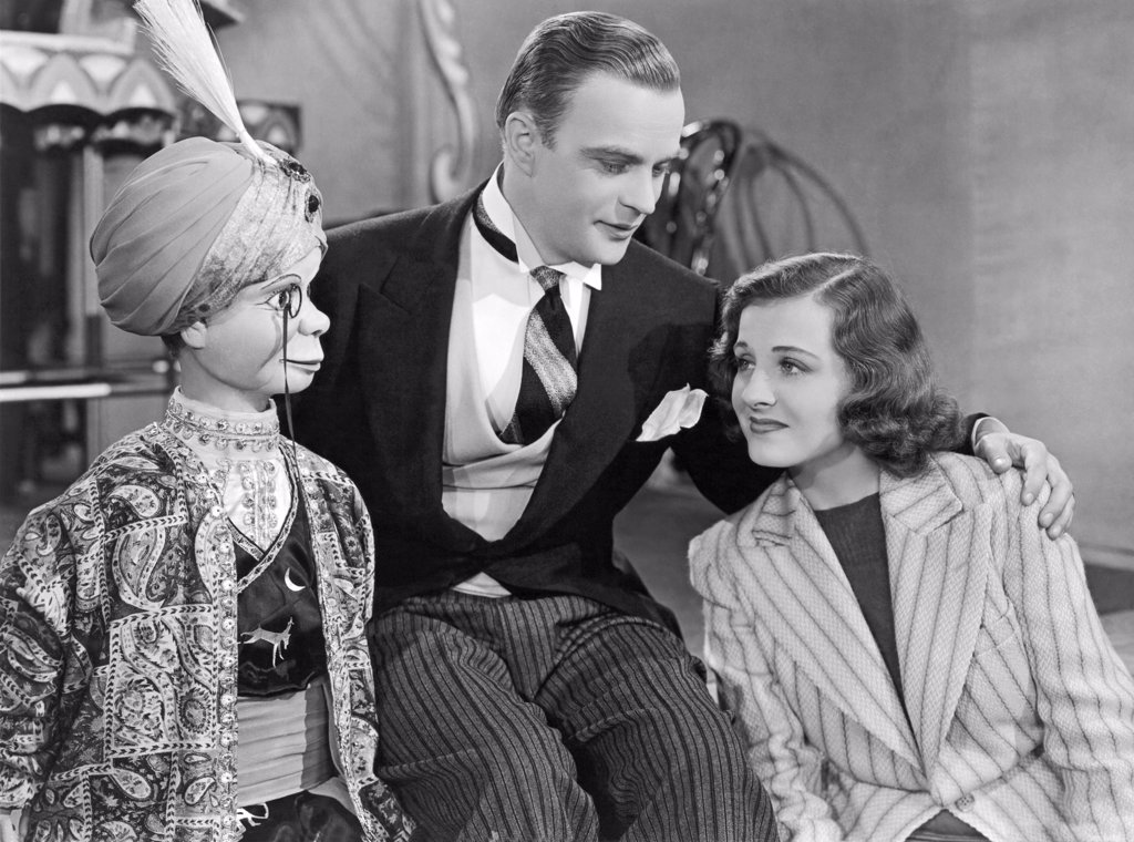 Stock Photo: 1035-11584 Hollywood, California:  1939. Edgar Bergen and Charlie McCarthy with Constance Moore in the film,'You Can't Cheat An Honest Man'.