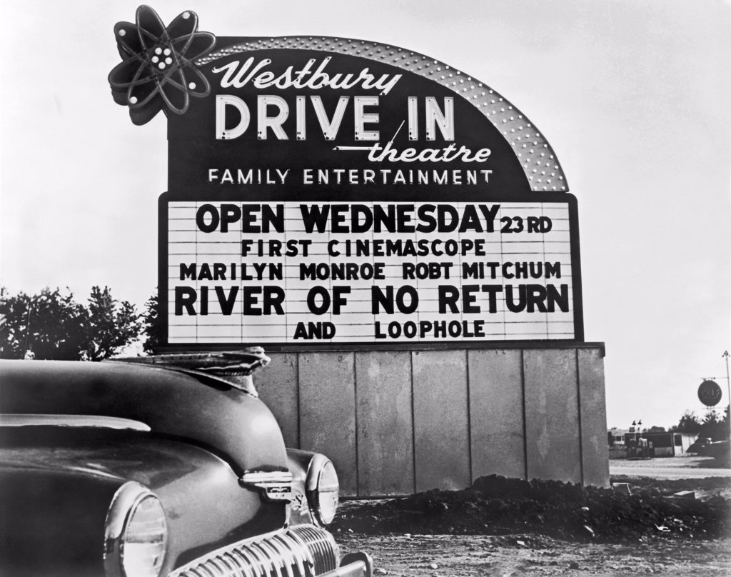 Stock Photo: 1035-11616 Westbury, New York:  1954. Drive-in theater sign advertising 'River Of No Return', starring Robert Mitchum and Marilyn Monroe.