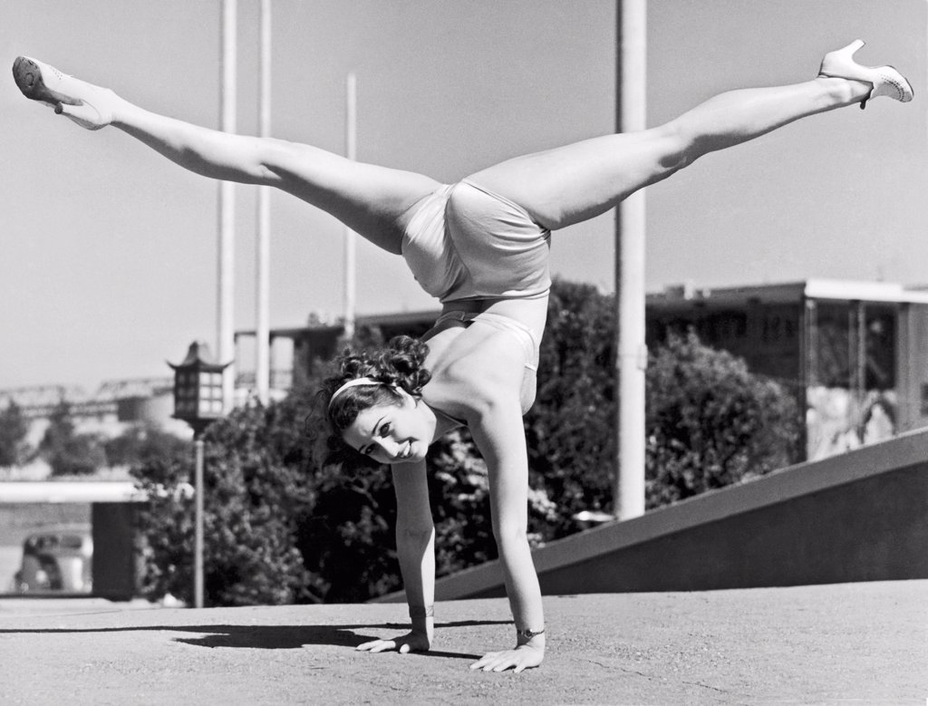 San Francisco, California:   1939. Sally Rand combines a hand stand with the splits at the Golden Gate International Exhibition on Treasure Island in San Francisco. : Stock Photo