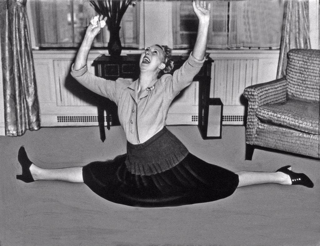 Stock Photo: 1035-11709 New York, New York:  1940. Charlotte Greenwood proves her agility despite the fact that she''s near the half-century mark.