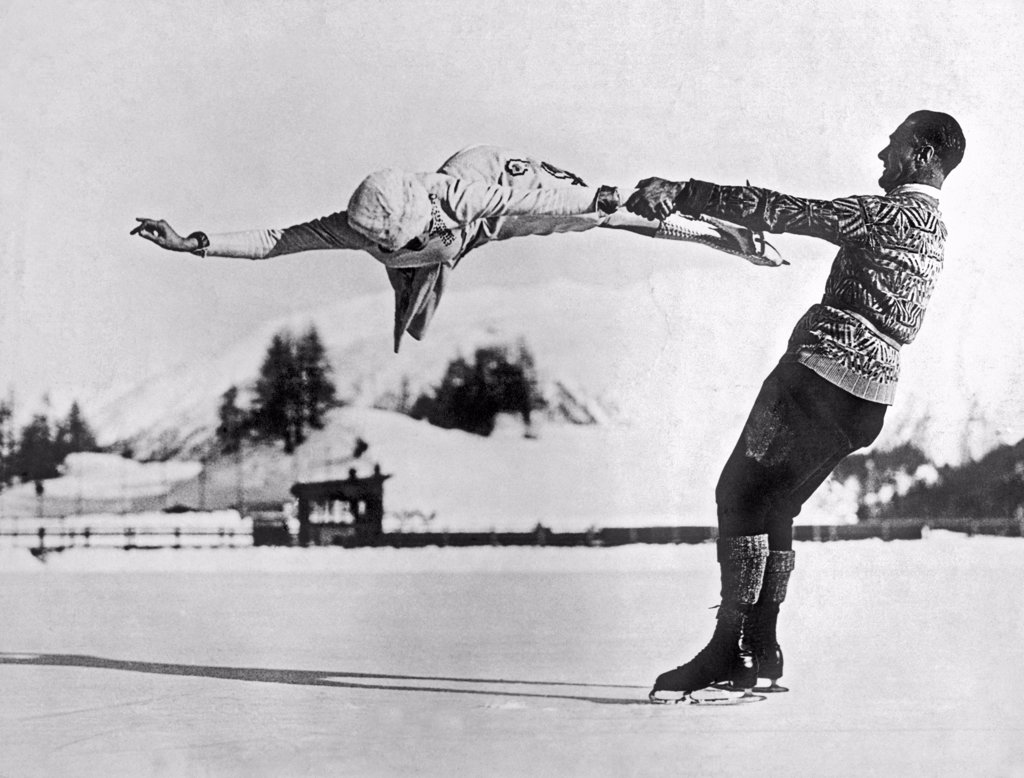 Stock Photo: 1035-11740 St. Moritz, Switzerland:  c. 1935. World-renowned New York figure skaters Freda Whitaker and Phil Taylor show some amazing acrobatics as they prepare for the next Winter Olympics.
