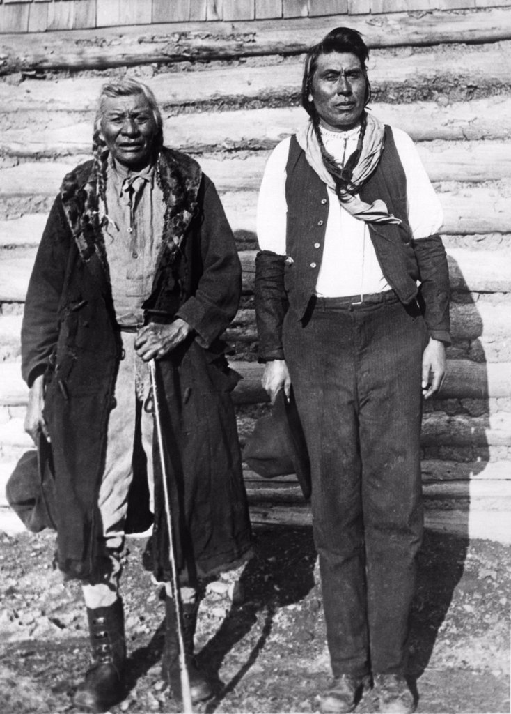 Stock Photo: 1035-1175 Native American man standing with his son, Montana, USA