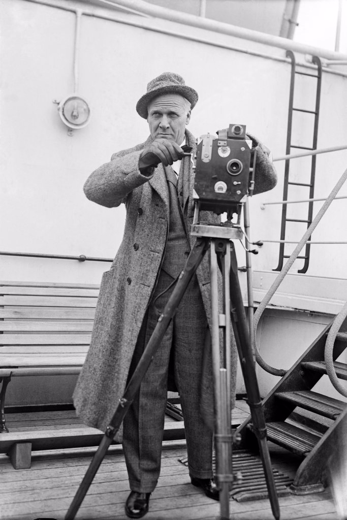 Stock Photo: 1035-11810 c. 1929. Russian opera singer Feodor Chaliapin aboard a ship with a movie camera.