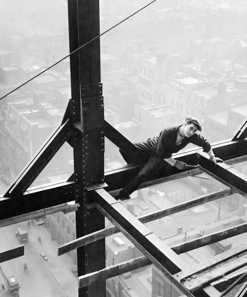 Stock Photo: 1035-11821 New York, New York:  1917. A man working on a girder on a sky scraper in a scene from the Fox Film, 'The Pride Of New York'.