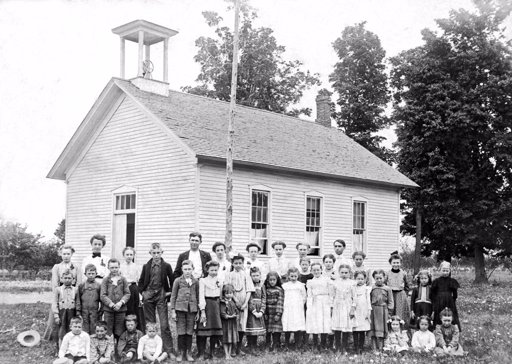 Stock Photo: 1035-11884 Grand Junction, Michigan:   c. 1890. A one room school house with the children of all ages.