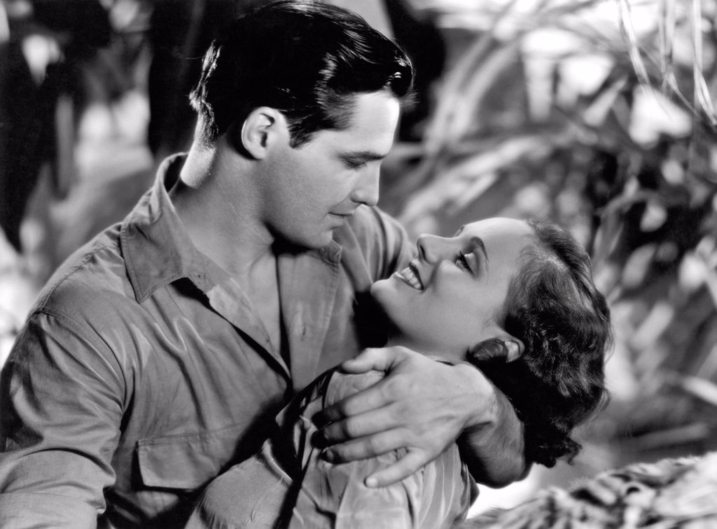 Hollywood, California:  1934. Marion Burns and Kane Richmond became so involved in their roles in 'Devil Tiger' that they just announced their marriage to each other. : Stock Photo