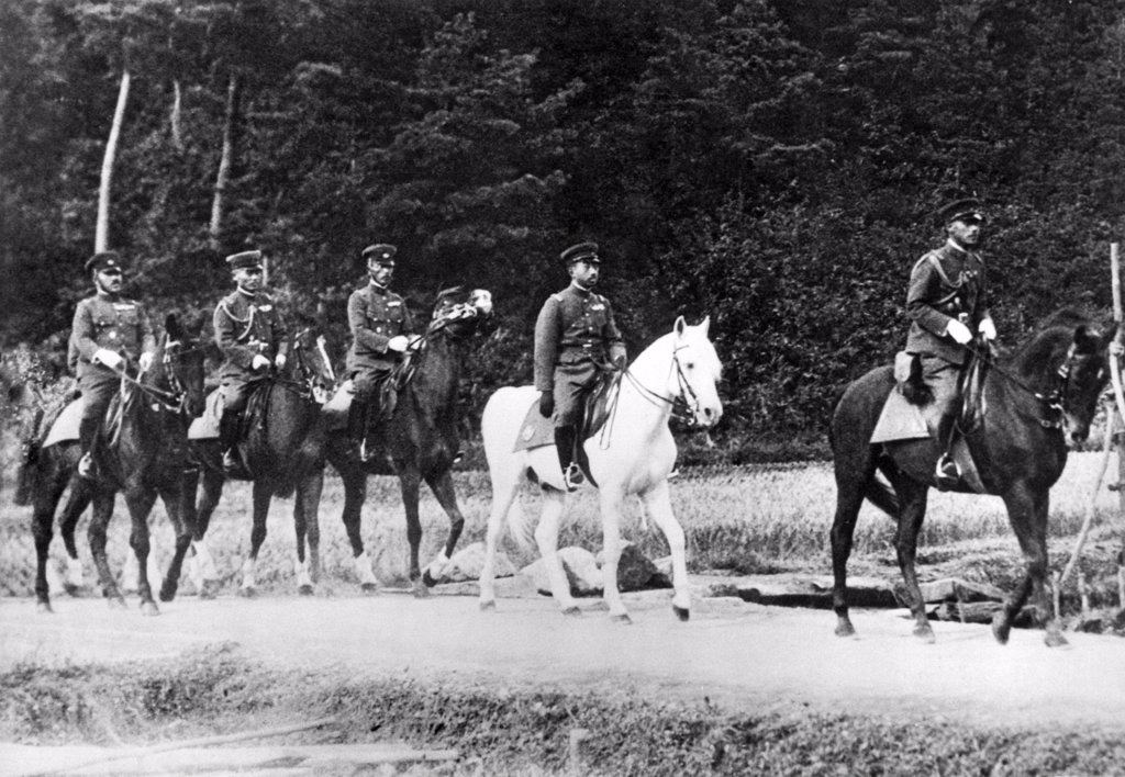Stock Photo: 1035-11977 Fukui Prefecture, Japan: November 7, 1933. Emperor Hirohito of Japan, mounted on his favorite white horse, 'Snow Drift', as he directed the annual war maneuvers in western Japan.