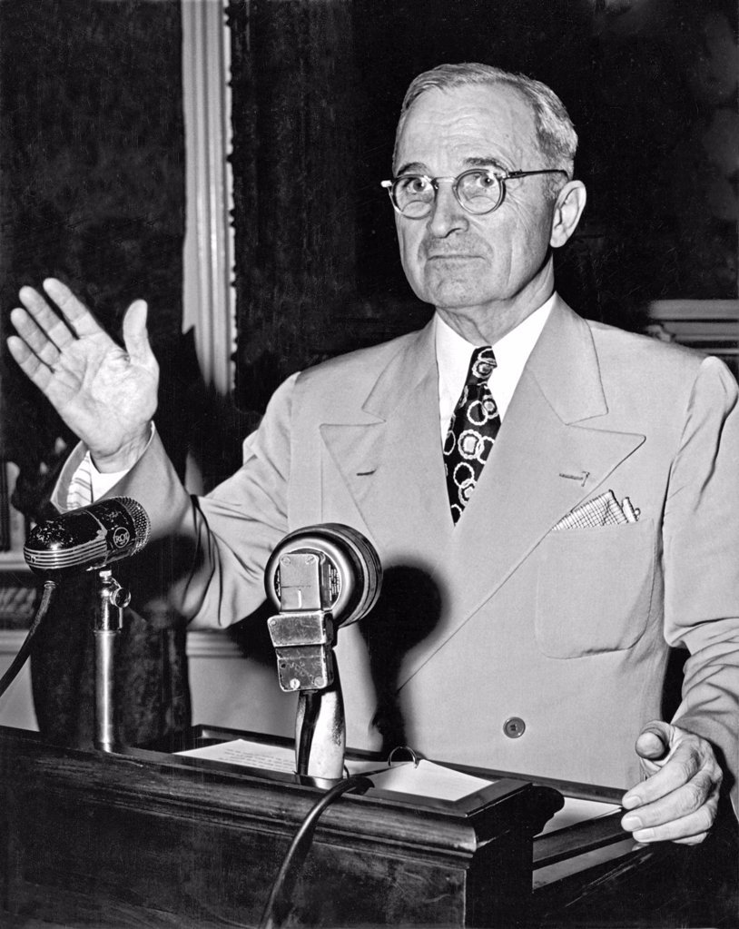 Stock Photo: 1035-11981 Washington, D.C.:   May 24, 1946. Truman concluding a press conference about the ongoing railroad strike, declaring that if the workers were not back on the job the next day, he would call upon the armed forces to help run the railroad and protect the strike breakers.