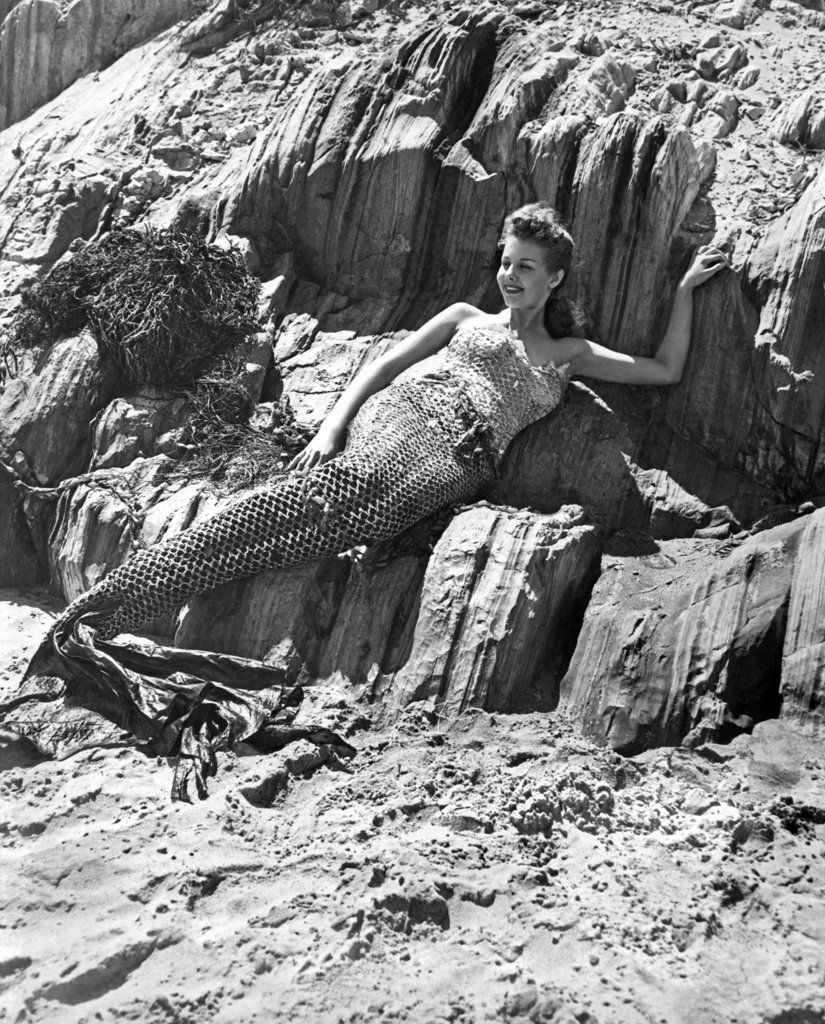 Los Angeles, California:  1947. A young woman poses as a mermaid with the hope of attracting a movie studio's interest. : Stock Photo