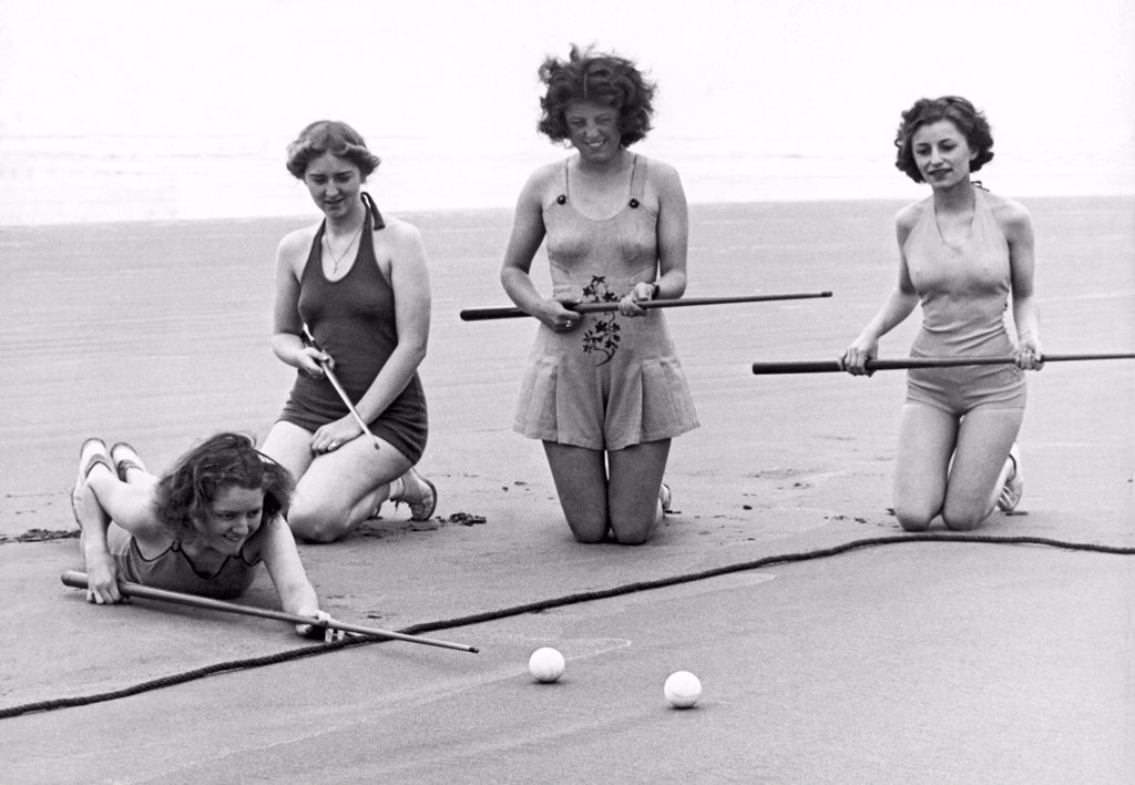 Stock Photo: 1035-12046 Seaside, Oregon:  c. 1937. The latest in beach sports in Oregon is sand pool, here being played by four of the lovely locals.