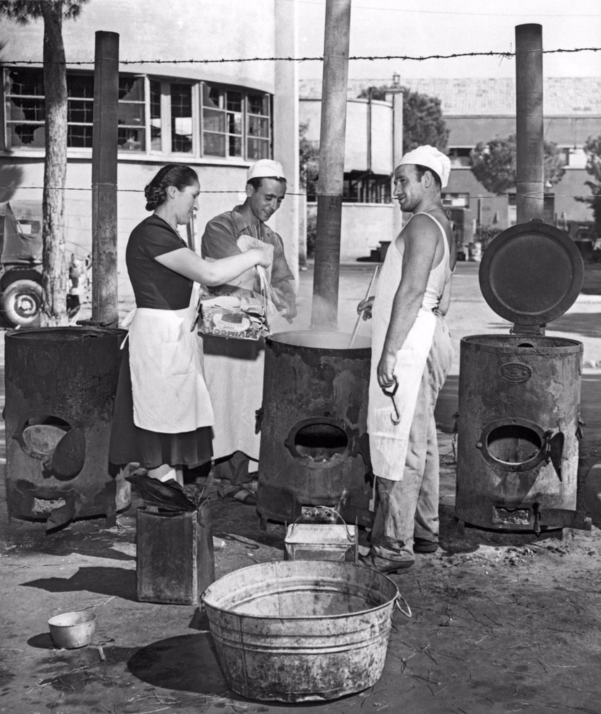 Rome, Italy:  August 23, 1947. Cinecitta, the fabulous movie making center built by Mussolini, now serves as a refugee camp in post war Italy. Here the cooks in one of the outdoor kitchens prepare macaroni for the refugees. : Stock Photo