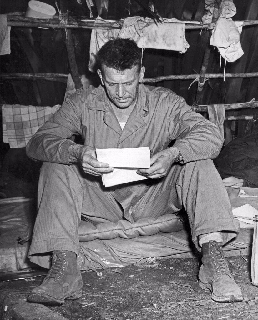 Stock Photo: 1035-12249 Enogai Inlet, New Georgia Islands, September, 1943. Col. Harry Liversedge,  Commanding Officer of the Marine Raiders, reads his first letter from home since he went into action. Regarded as one of the greatest combat leaders in Marine Corps history, in 1945 he led his Combat Team 28 to the top of Mount Suribachi on Iwo Jima, an event made famous by Joe Rosenthal's iconic image of the flag being raised by five Marines and a Navy medic.