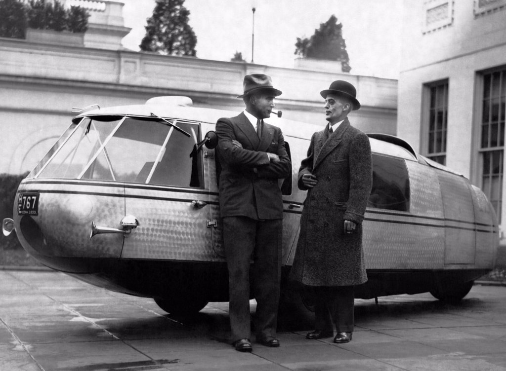 Washington, D.C.:  November 13, 1933 Captain Al Williams, noted speed flyer and driver, and Marvin McIntyre, Secretary to President Roosevelt, standing by the Dymaxion concept car designed by Buckminster Fuller. : Stock Photo
