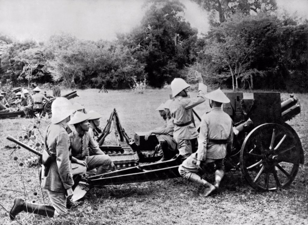 Stock Photo: 1035-12403 Indochina:  c. 1910. French cannoniers instructing the Indochinese in the use of modern armaments.