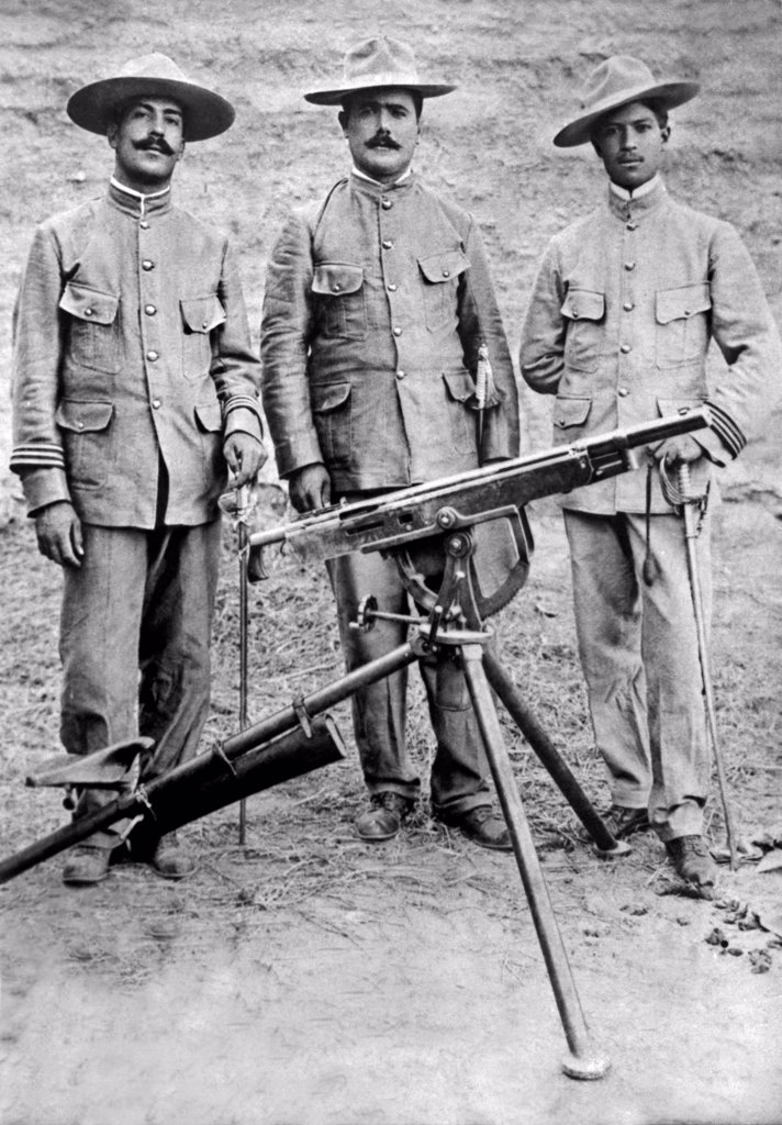 Mexico:  November 20, 1913. The commanders of the highly regarded Mexican rebel machine-gun regiment. Left-Right: Captain Antonio Guirrero, Colonel Alvaro Obregon, Captain Jose Rocha. : Stock Photo