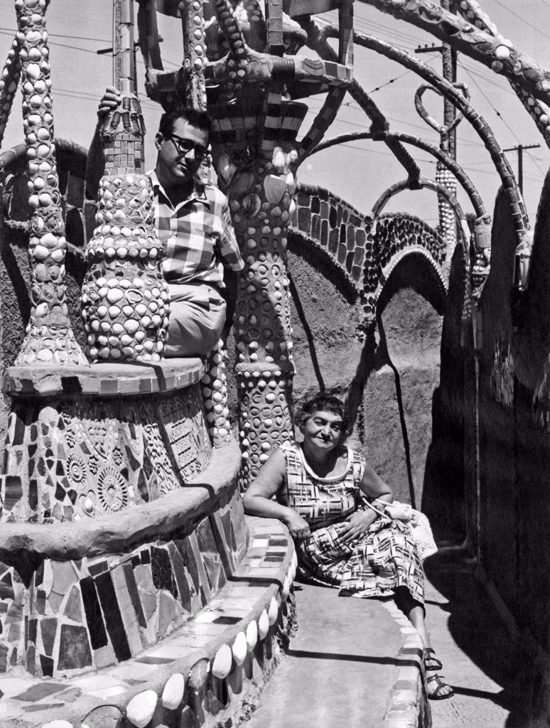Stock Photo: 1035-12411 Los Angeles, California:  c. 1960. Two visitors at the Watts Towers in the Watts distirct of Los Angeles.