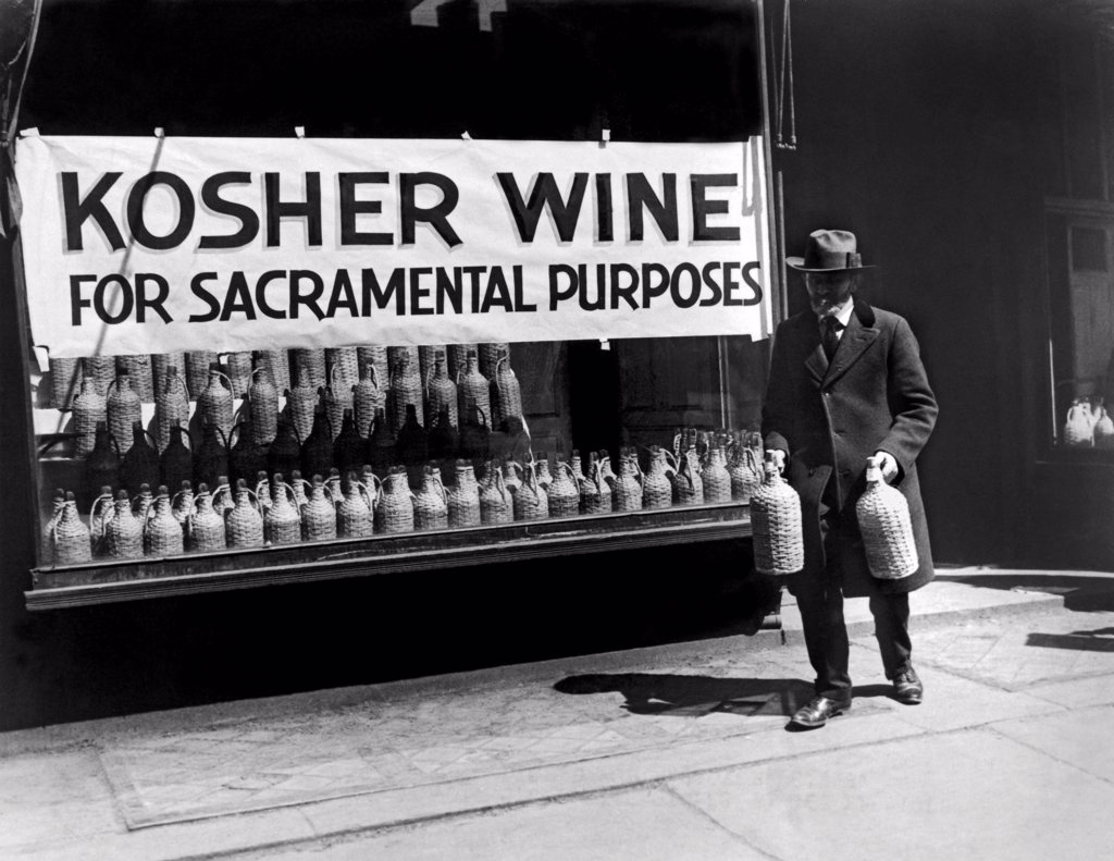 Stock Photo: 1035-12418 New York, New York:  c. 1930 A Jewish man buying kosher wine for sacramental purposes.