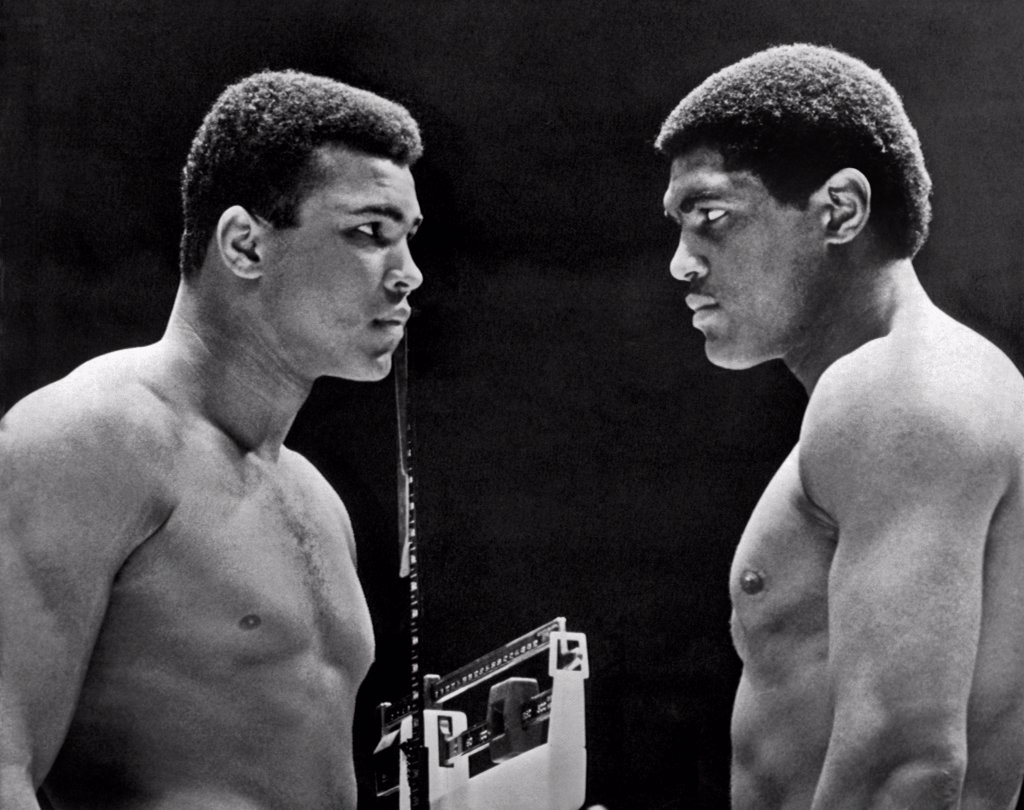 Houston, Texas:   February, 6, 1967. Heavyweight champion Cassius Clay focuses his whammy eye on challenger Ernie Terrell during the weigh in for tonight's title fight. : Stock Photo
