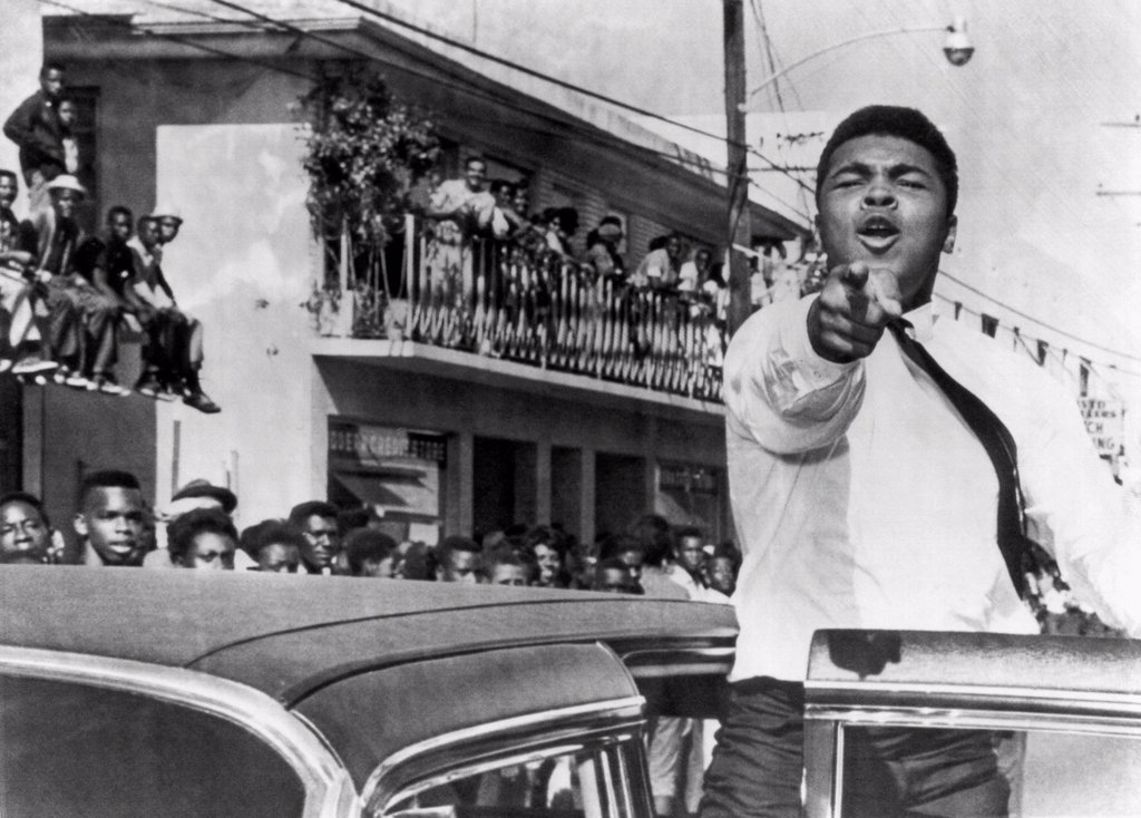 Stock Photo: 1035-12426 Miami, Florida:  December 14, 1963. Cassius Clay who is training in Miami for his title fight against Sonny Liston, takes part in a pre football game parade.