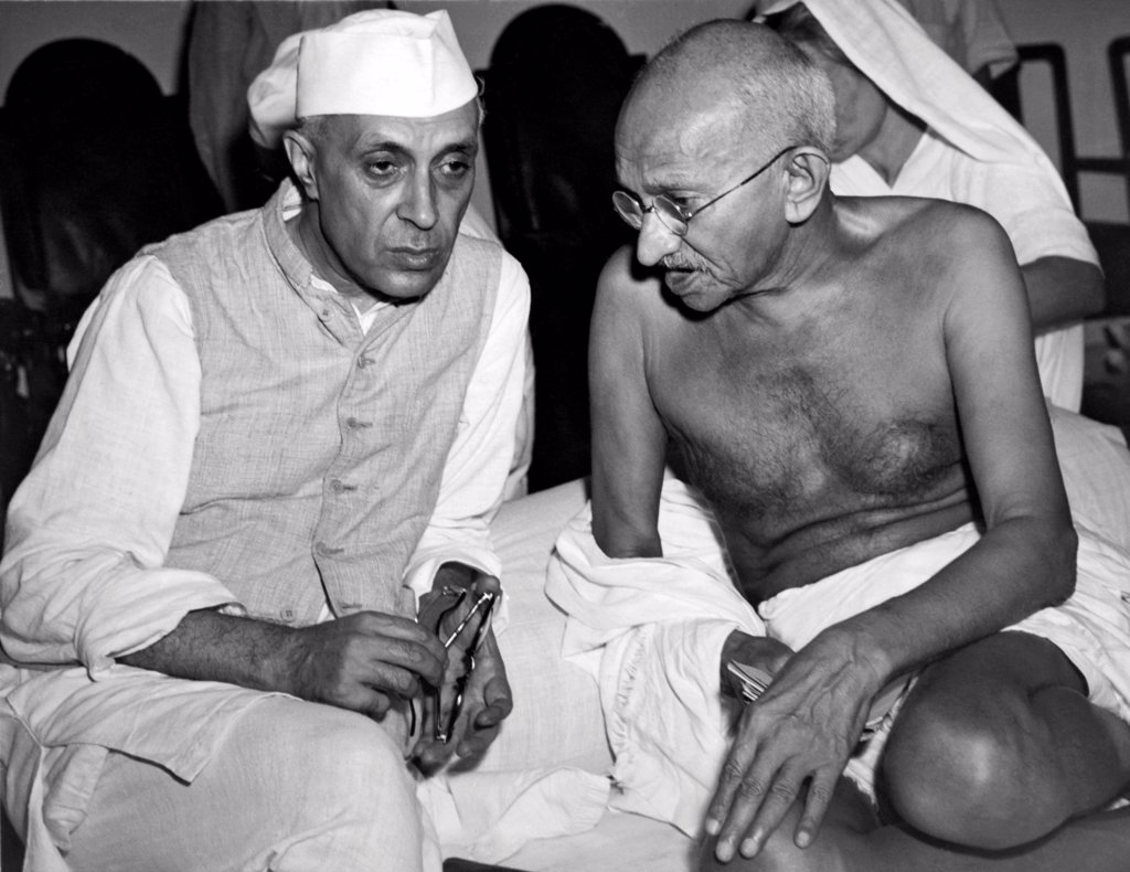 Bombay, India:  July 15, 1946 jawaharlal Nehru, the newly elected President of the All India Congress, talking with Mahatma Gandhi, Indian political strong man, at a meeting of the Congress. : Stock Photo