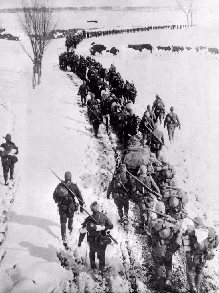 Stock Photo: 1035-12468 Chaoyang, Manchuria:  March, 1933. Troops of the Japanese 6th Division infantry trudge through a foot of snow in zero degeree weather on their way to Chaoyang and then on to Chifeng in Inner Mongolia.