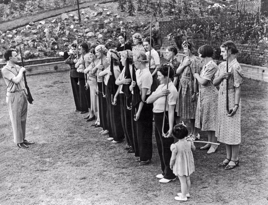 Stock Photo: 1035-12492 London, England:  August 10, 1940. Twenty units of the Amazon Defense Corps have been trained by England's Home Guard in preparation for a Nazi invasion. Here the women are being trained in the use of firearms.