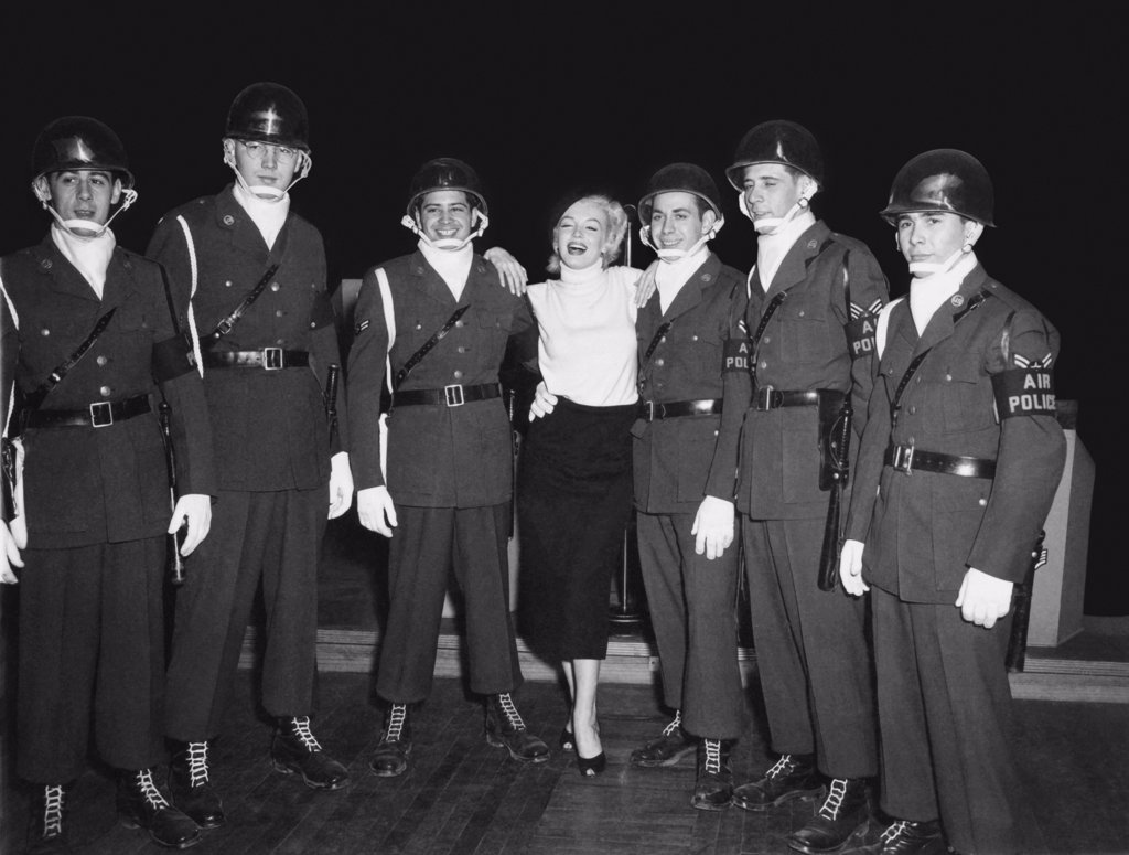 Stock Photo: 1035-12576 Korea:  February, 1954. Marilyn Monroe visits the troops in Korea, entertaining over 100,000 soldiers in 10 different locations.