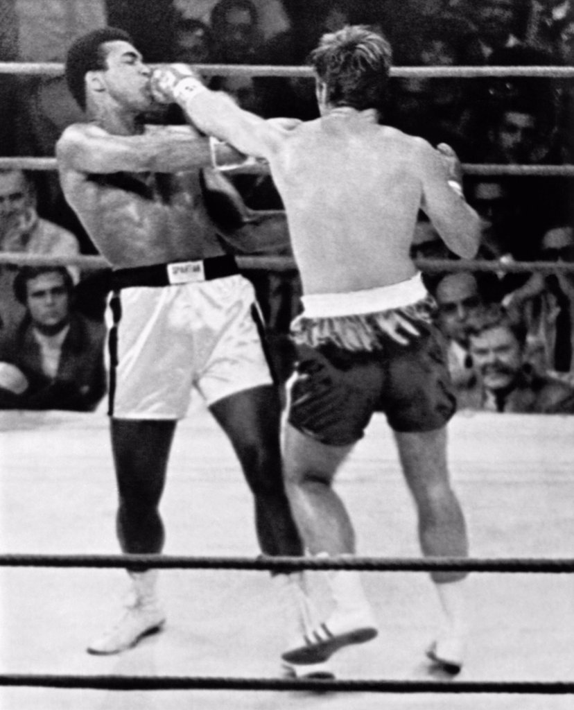 Stock Photo: 1035-12594 Atlanta, Georgia:  October 26, 1970 Jerry Quarry slams a left into Muhammad Ali's mouth in the second round of their fight. The fight was stopped after the third round because of Quarry's badly battered eye.