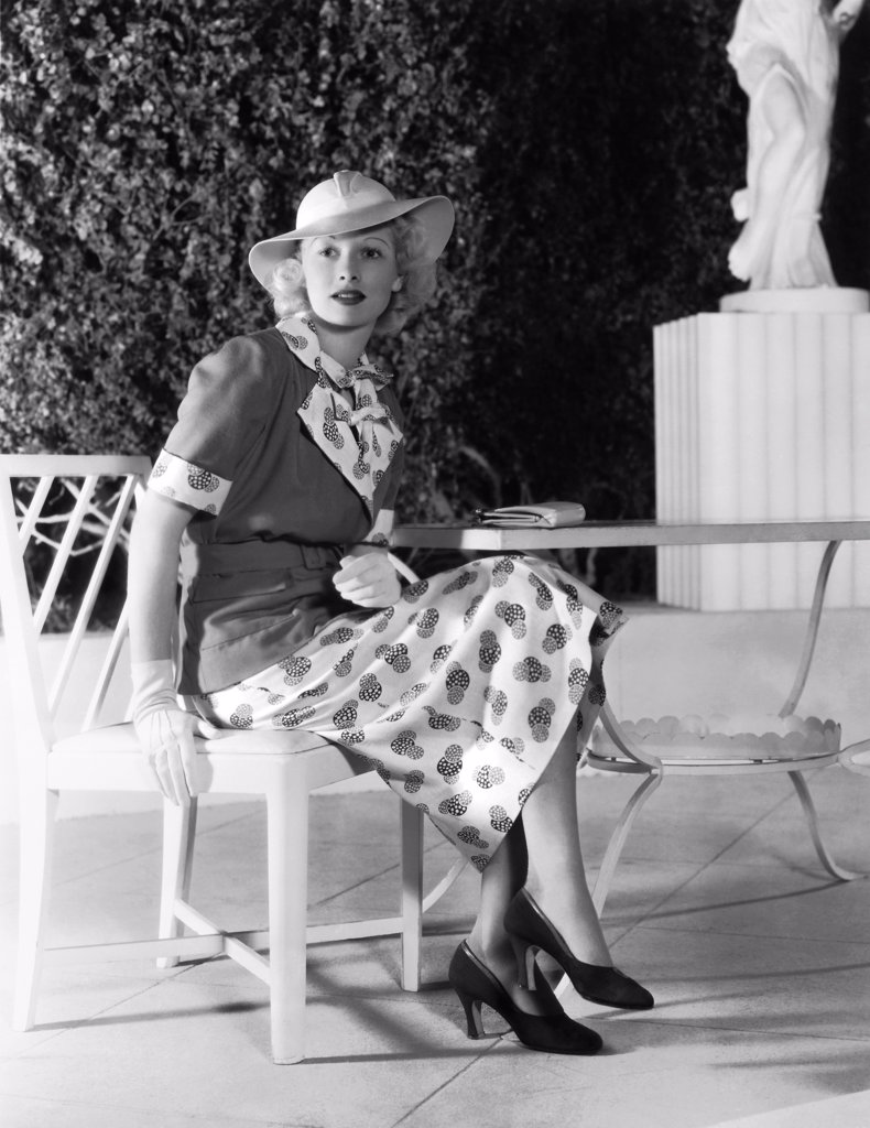 Stock Photo: 1035-12606 Hollywood, California:  1936 Actress Lucille Ball, popular RKO Radio Pictures player, displays the latest in spring fashion.