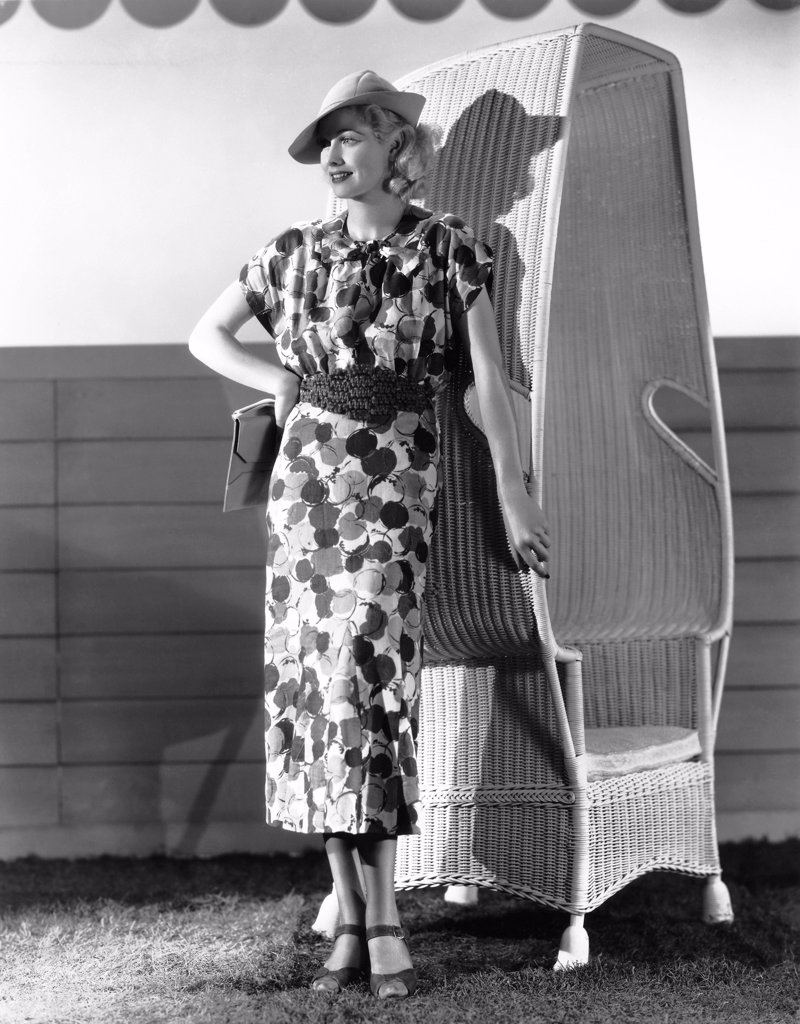 Stock Photo: 1035-12607 Hollywood, California:  1936 Actress Lucille Ball, popular RKO Radio Pictures player, models the latest in printed linen for spring fashions.