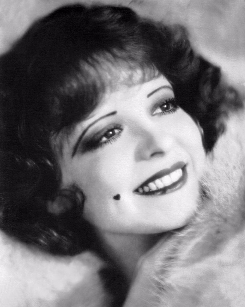 Stock Photo: 1035-12617 Hollywood, California:  1926  A photograph of a smiling Clara Bow, 'The It Girl'.