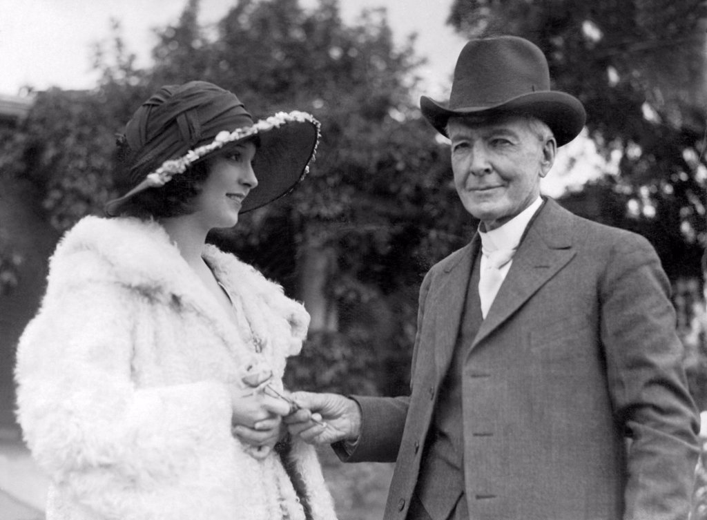 Santa Rosa, California:    1923 Luther Burbank presents movie actress Madge Bellamy a flower from his garden. : Stock Photo