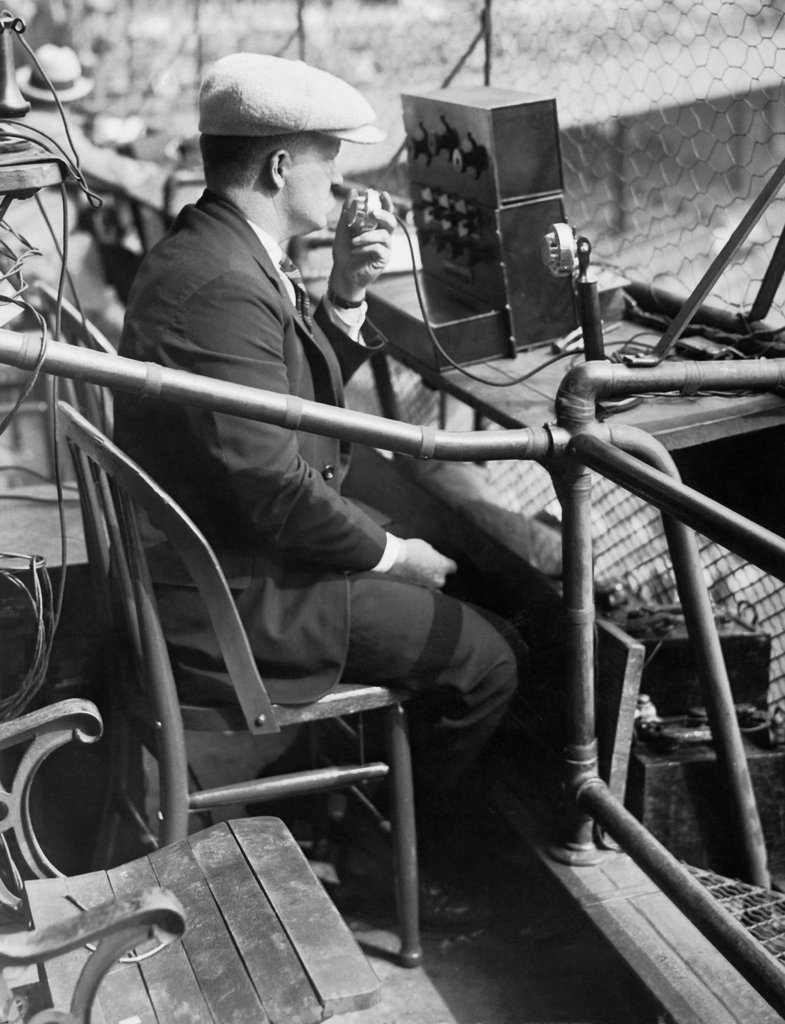 Stock Photo: 1035-12801 New York, New York:  October 6, 1924 An AT&T engineer tests out his company's equipment for broadcasting the third game of the 1924 World Series at the Polo Grounds in New York.