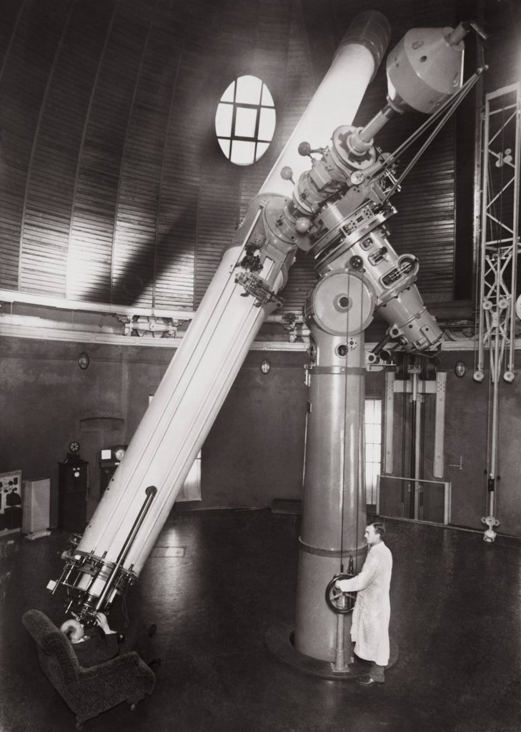 Stock Photo: 1035-144 Man looking through an refracting telescope, Berlin Observatory, Babelsberg, Germany