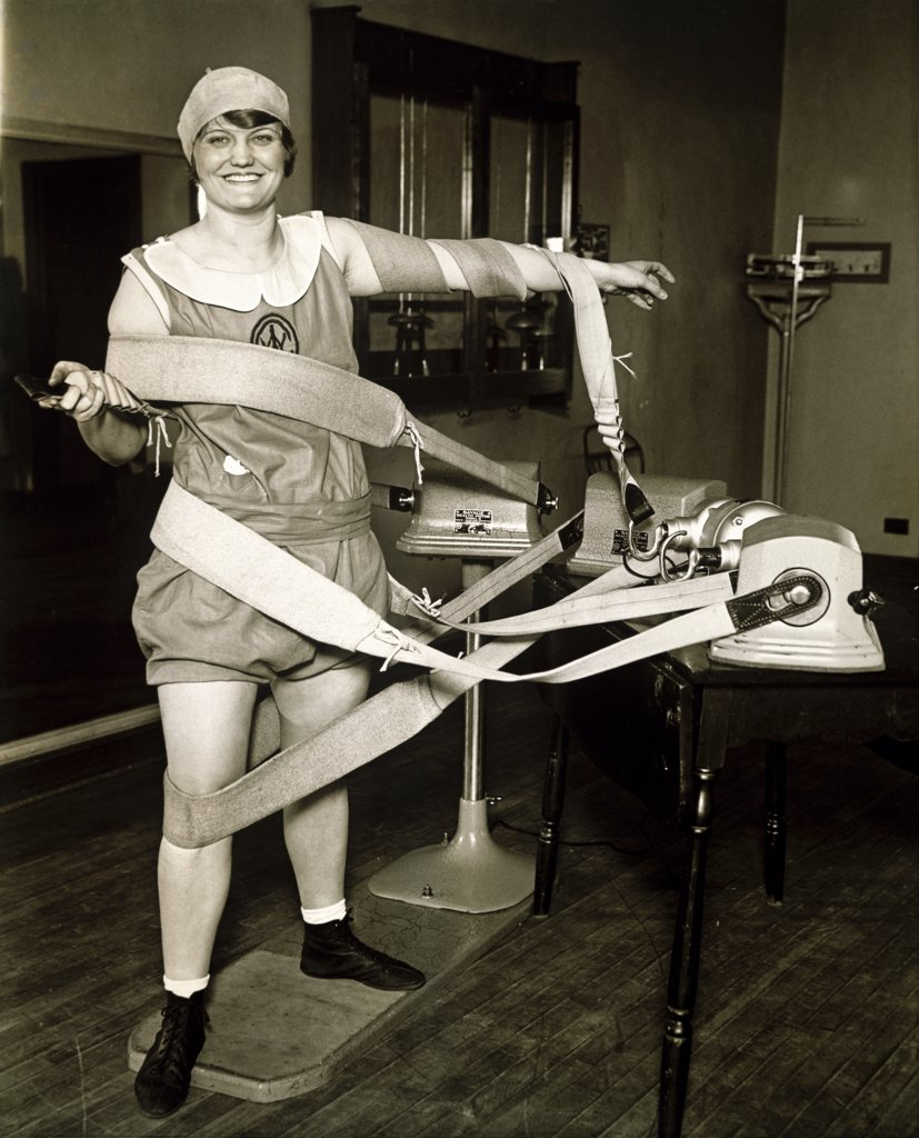 Stock Photo: 1035-227 Portrait of a mid adult woman exercising on an electric vibrating machine