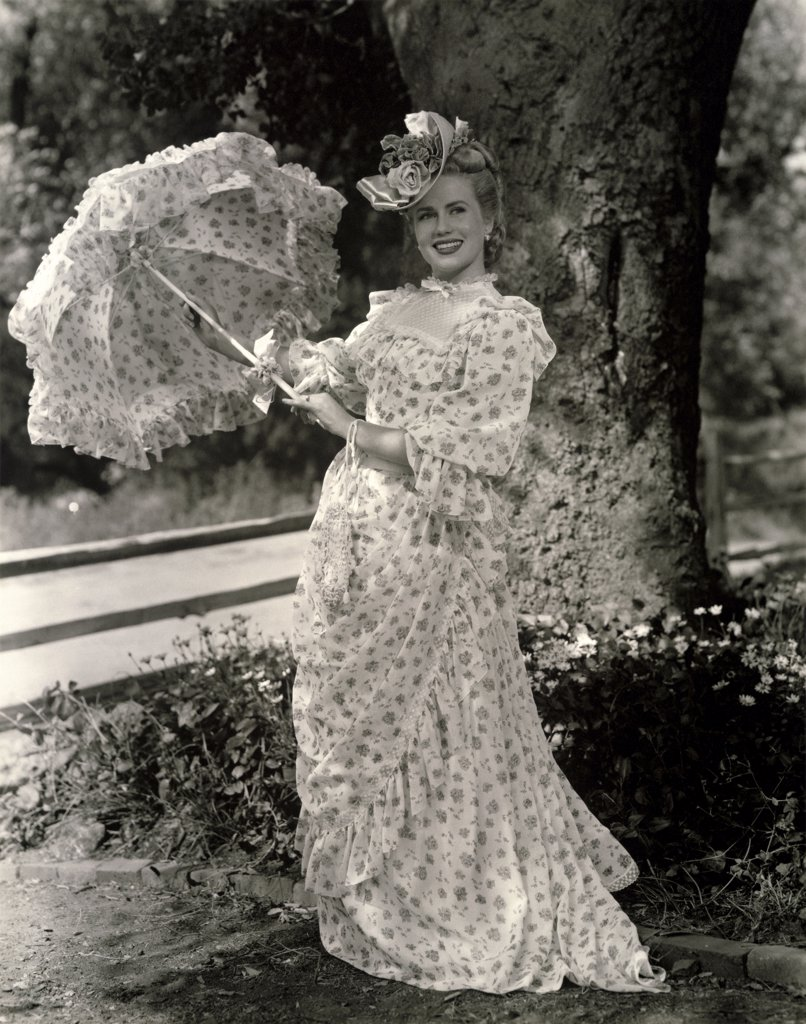 Stock Photo: 1035-240 Young woman holding a parasol