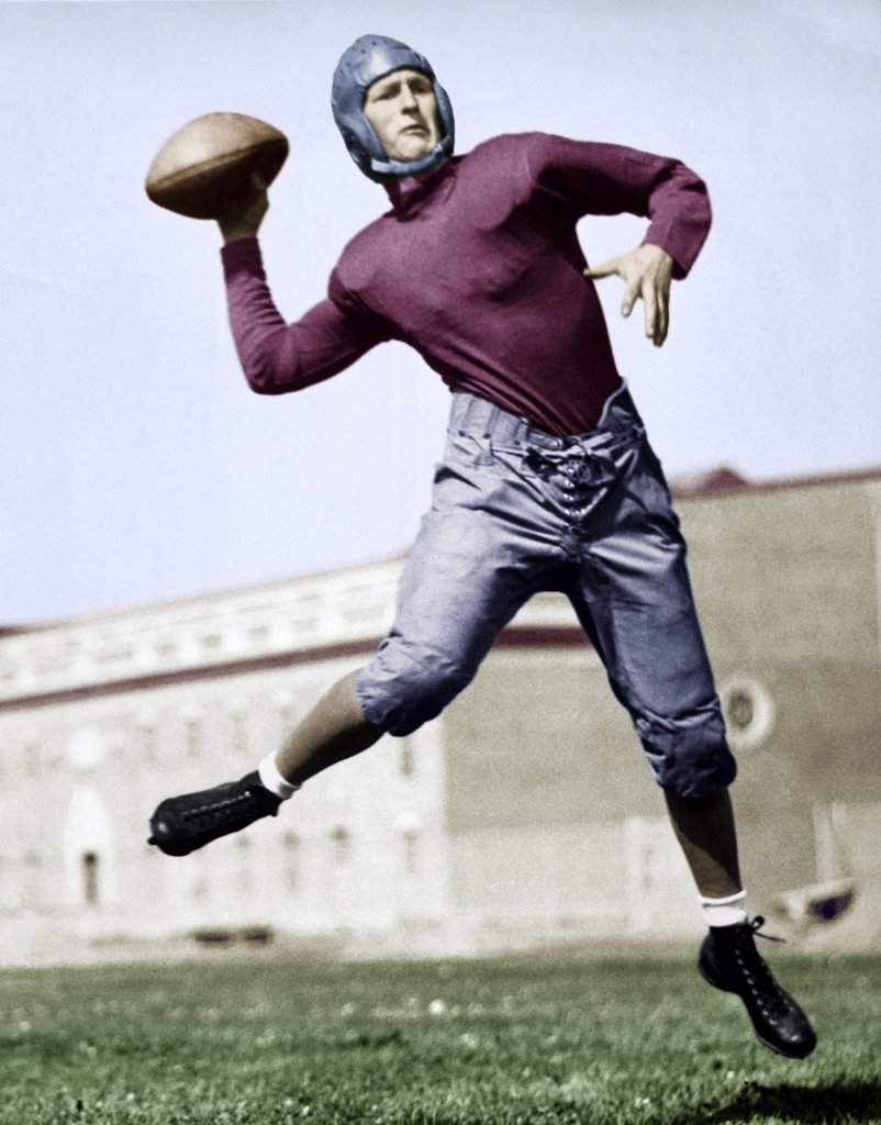 Football player throwing a football