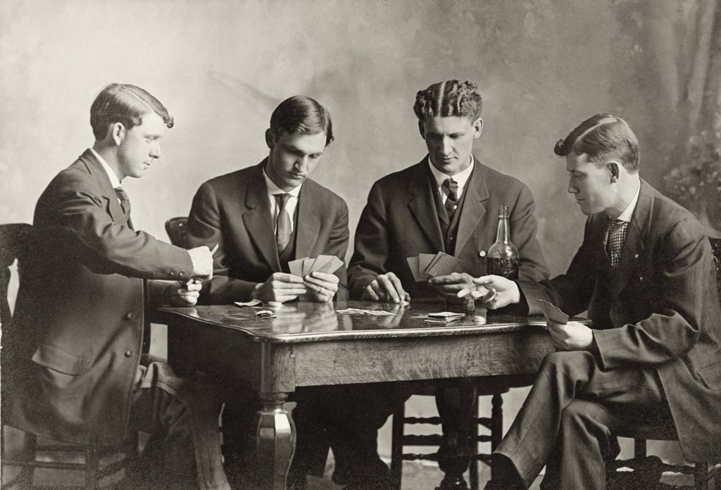Stock Photo: 1035-331 Four young men playing cards