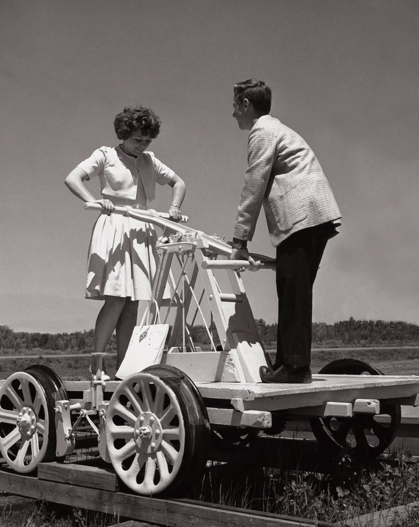 Stock Photo: 1035-412 Teenage girl and a teenage boy on a tandem rail trolley
