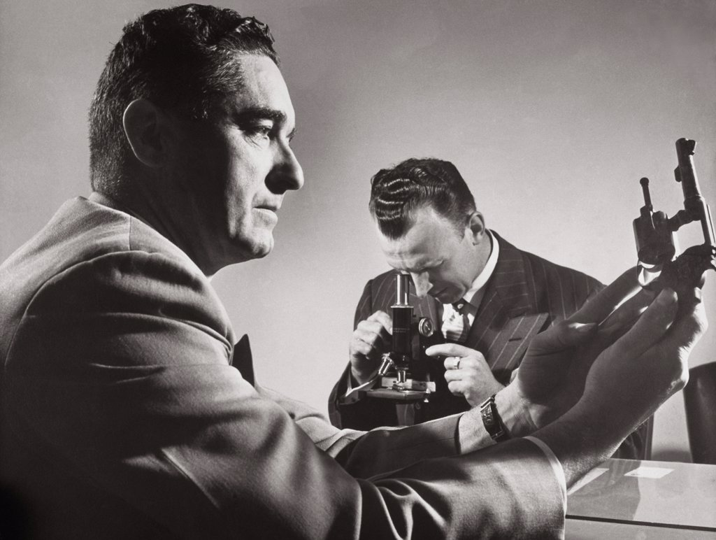 Stock Photo: 1035-812 Close-up of two male scientists researching in a laboratory