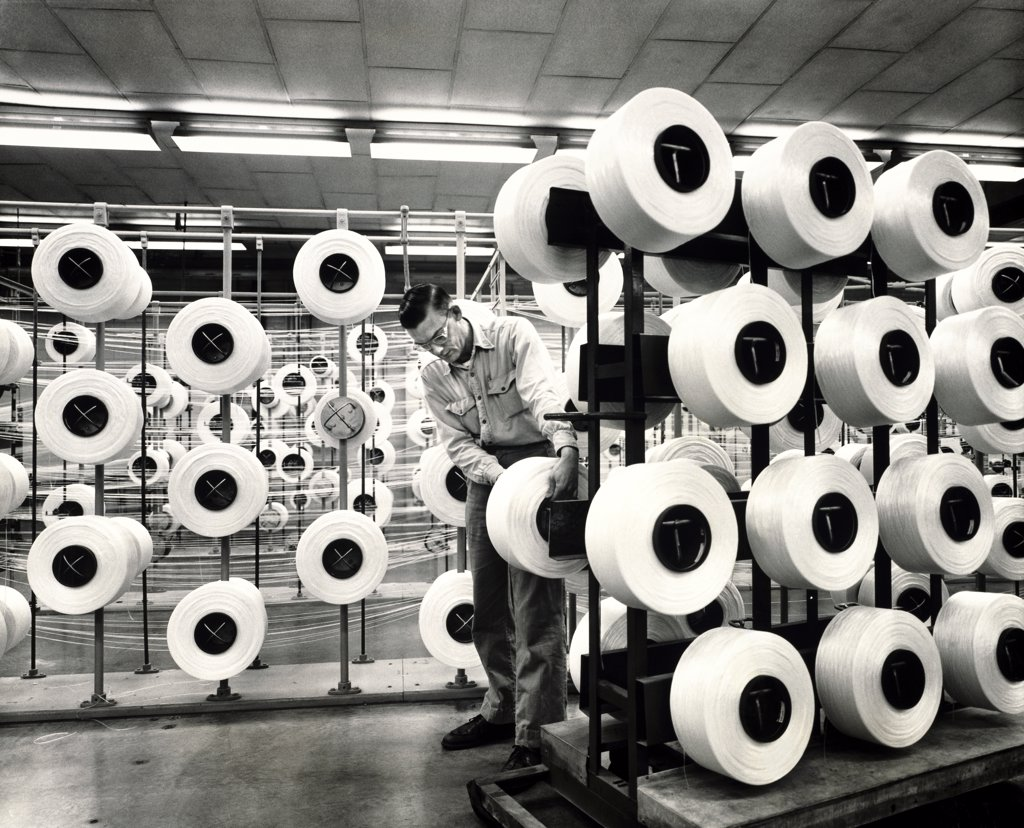 Stock Photo: 1035-907 Mid adult man working in a textile factory, Allied Chemical, Chesterfield, Virginia, USA